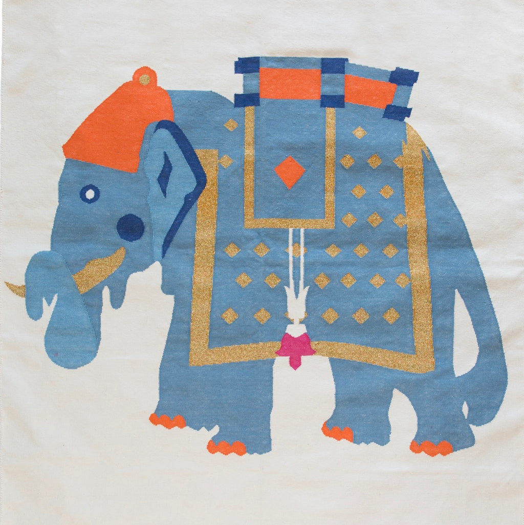 Mahout Elephant in multi colour Dhurrie Rug on an Off White background
