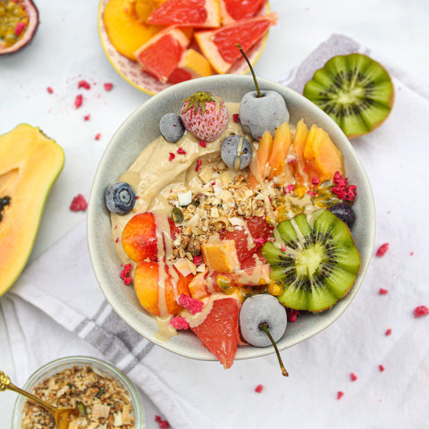 tropical fruit protein smoothie breakfast bowl