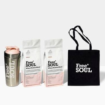 Image showing 2 white and pink bags of Free Soul's Whey Protein Blend, steel shaker and black tote bag.
