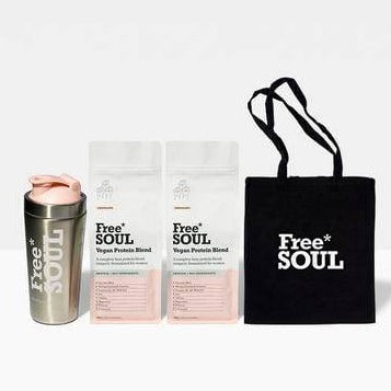 A set of 2 white and pink bags of Free Soul's Vegan Protein Blend, steel shaker and a black tote bag.