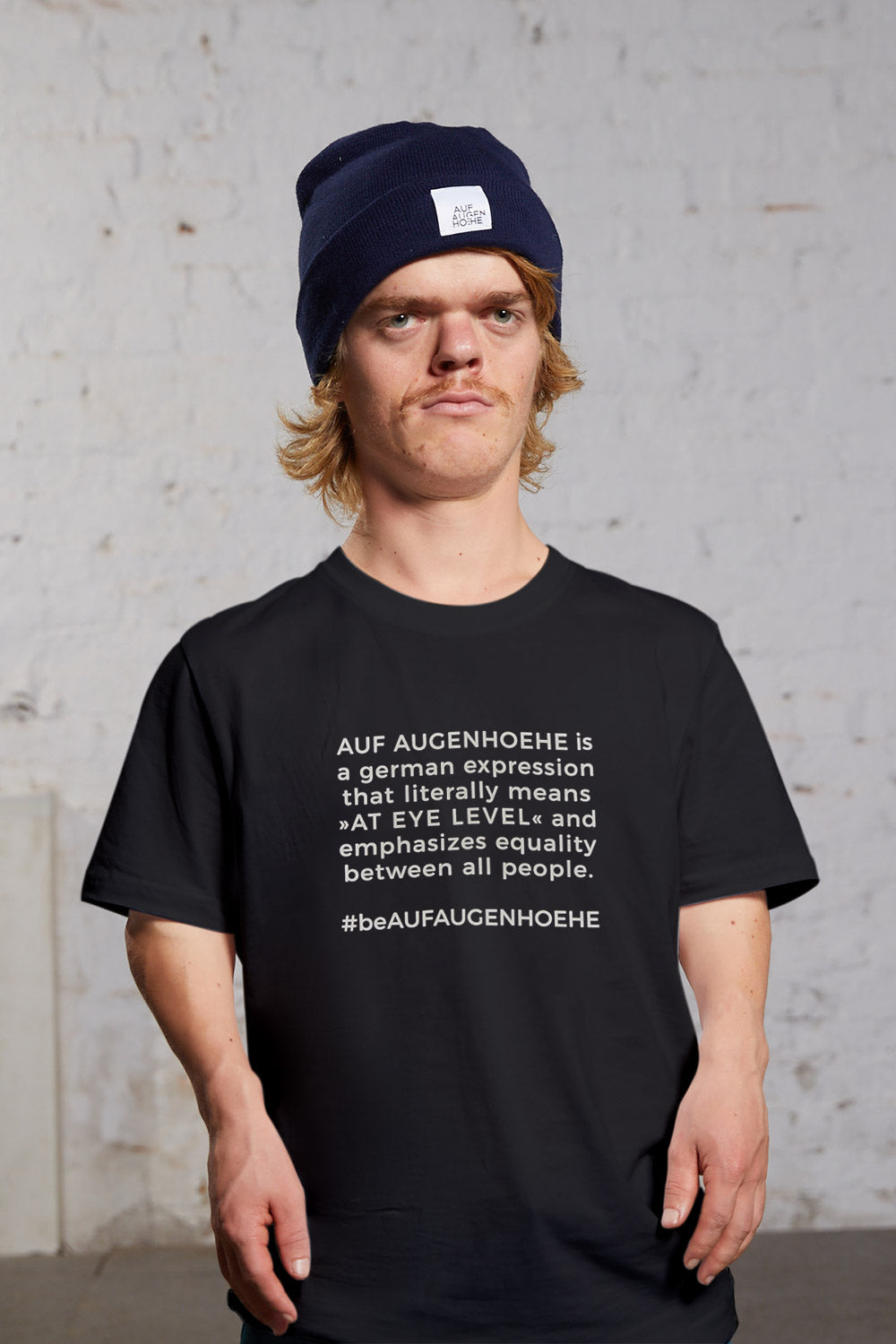 man with dwarfism wearing black shirt with a statement text