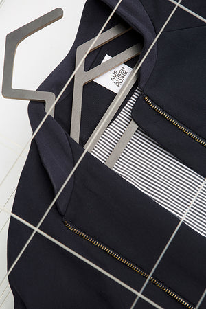 detailed view of dark blue college jacket with striped lining for people with dwarfism
