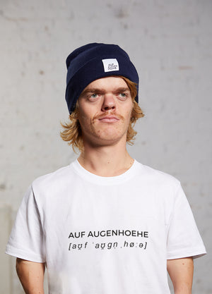 man with dwarfism wearing a white t-shirt with black text