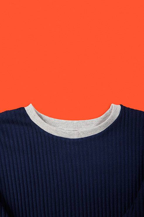 detailed view of blue pullovers collar