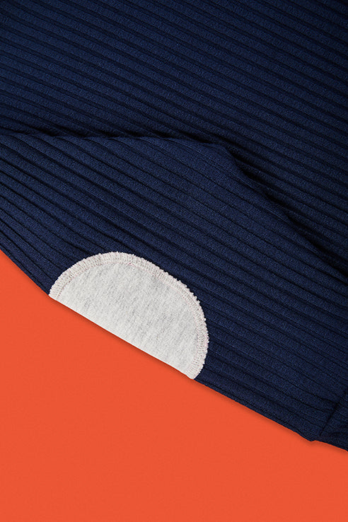 detailed view of grey application at elbow of blue pullover