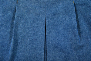 detailed view of folds of jeans skirt