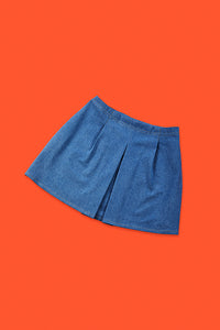 blue jeans skirt for people with dwarfism on red background