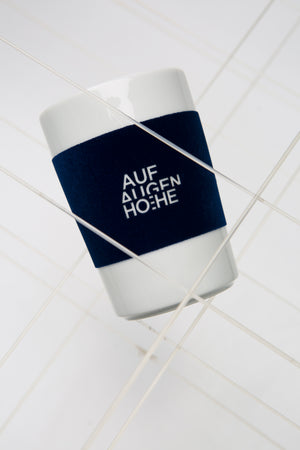 mug with felted surface in blue with white logo