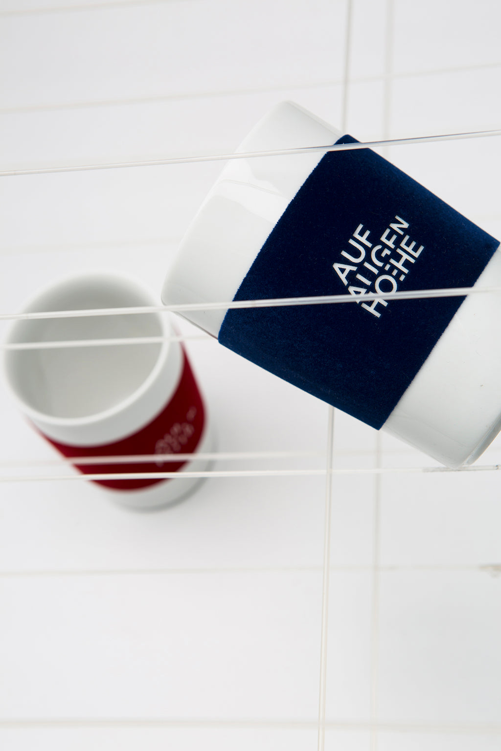 two mugs with logo in red and blue