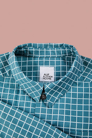 detailed view of blue grid pattern shirts collar