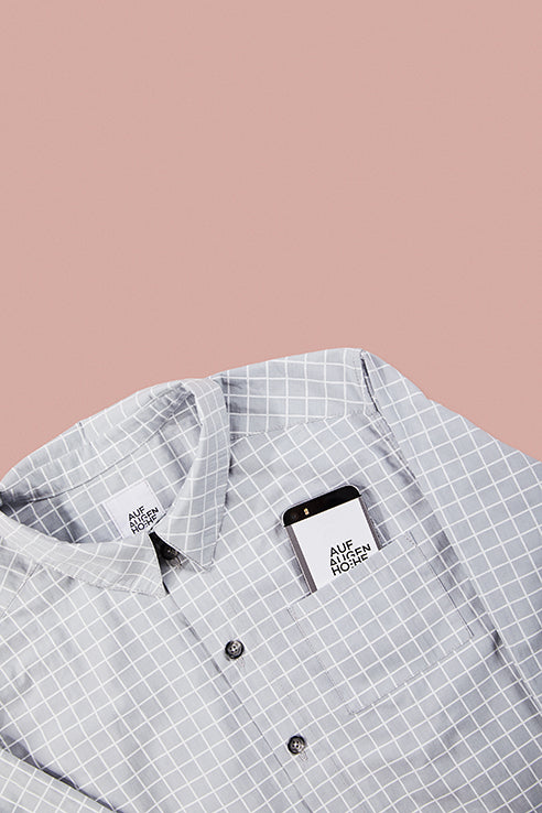 detailed view of grey grid patterned shirts collar