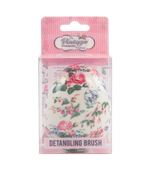 detangling brush in floral pattern packaging