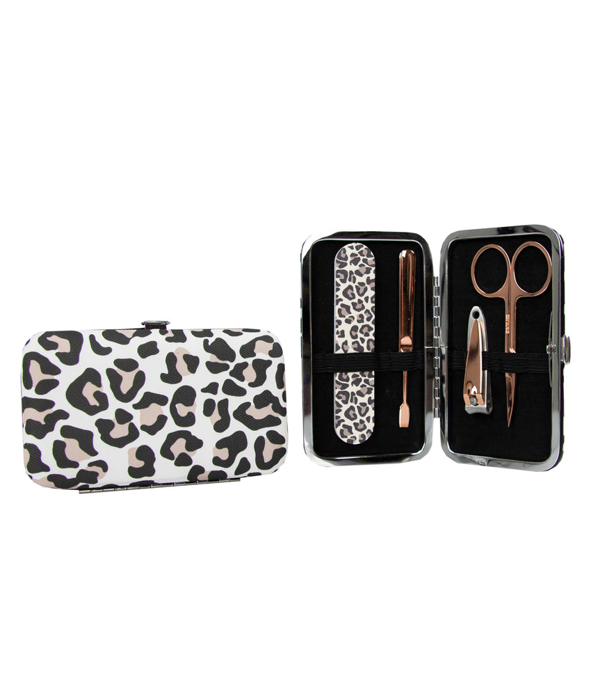 manicure purse in leopard print with nail scissors clippers cuticle pusher and emery board