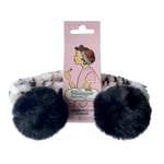 make-up headband in leopard print with black pom poms packaging