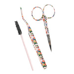 floral scissors, lash applicator and mascara wand