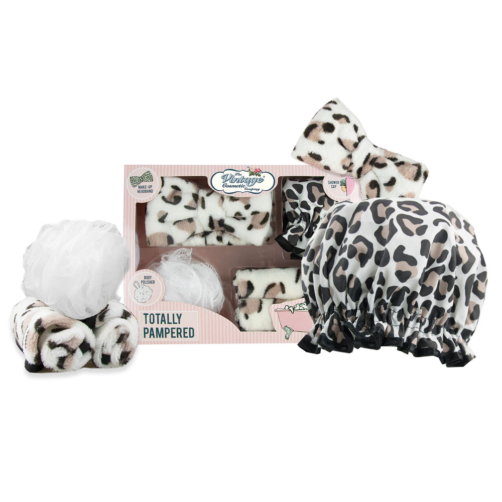 totally pampered gift set in leopard print shower cap make-up removing cloths make-up headband and body polisher