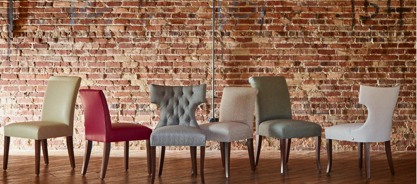 The Cudo Dining Chair lined up against a brick wall