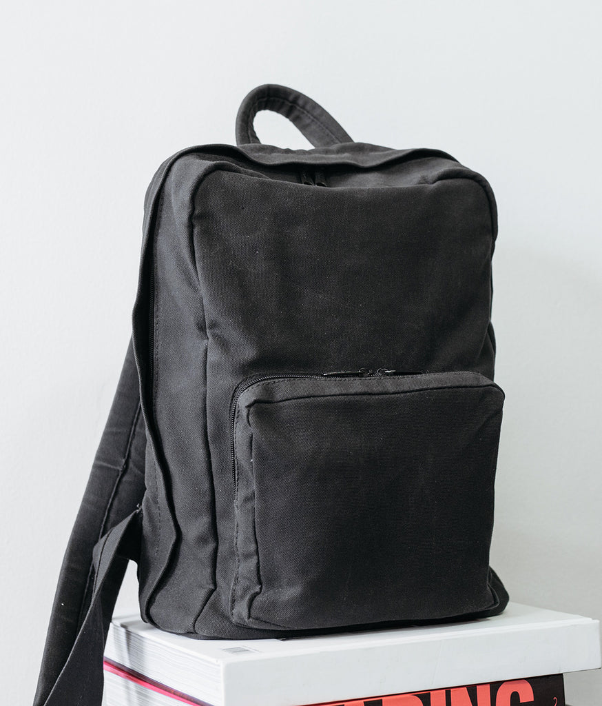 backpack made from vegan waxed canvas and recycled water bottles