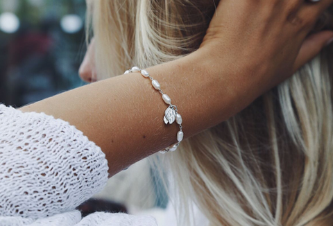 White Pearls Bracelet with Wings