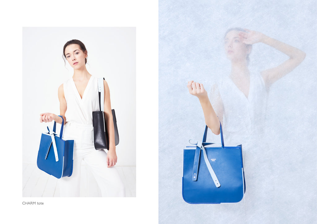 Dream's Code electric blue leather tote bag with white details