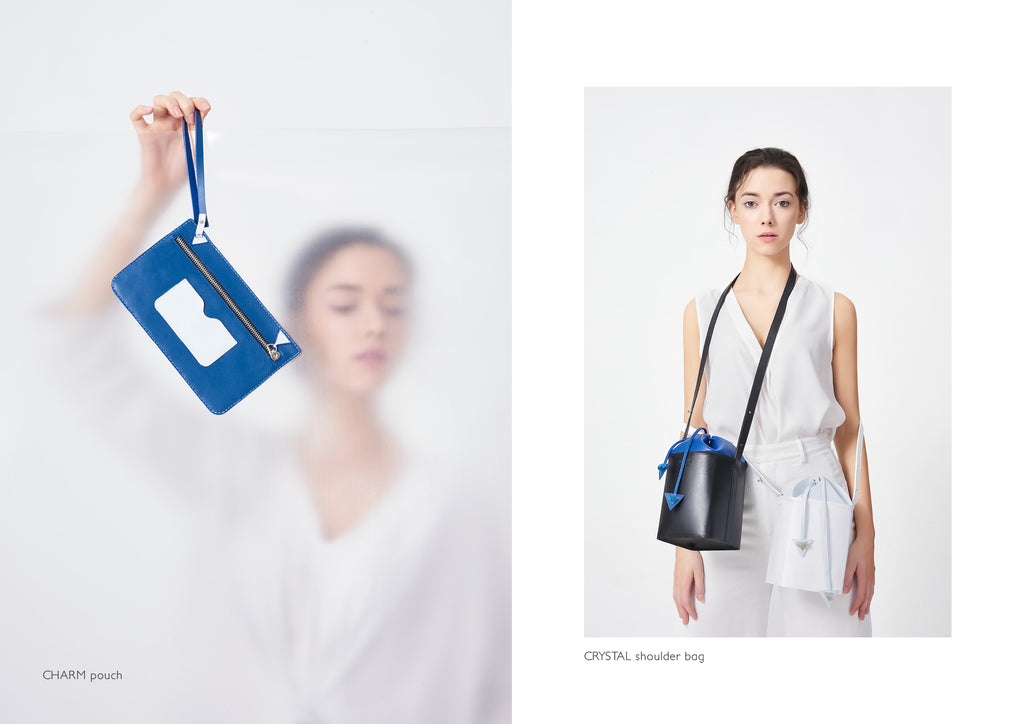 Dream's Code electric blue leather pouch with white details + black leather bucket bag