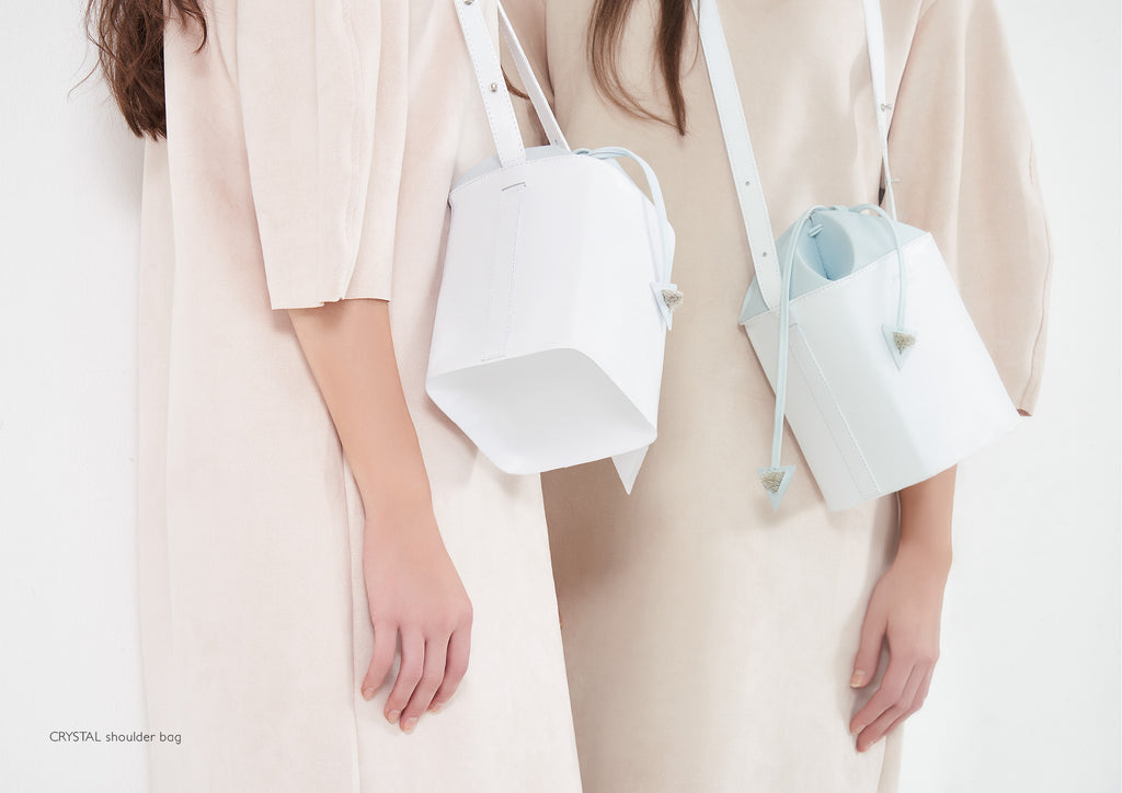 Dream's Code white and light blue leather bucket bag with origami artwork