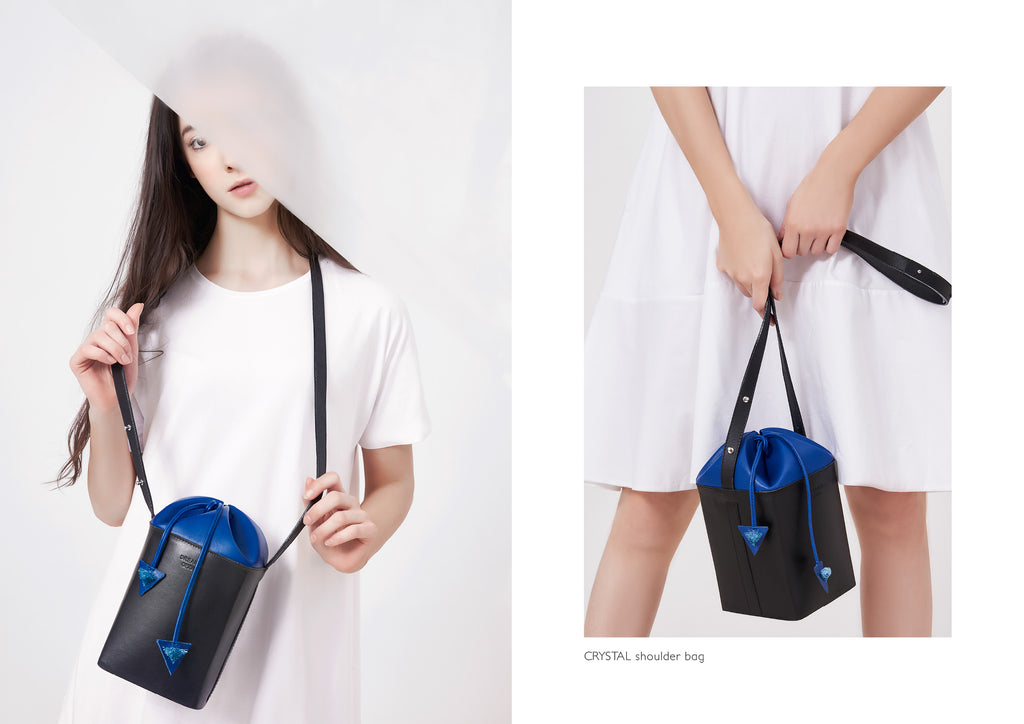 Dream's Code black and electric blue leather bucket bag with origami artwork