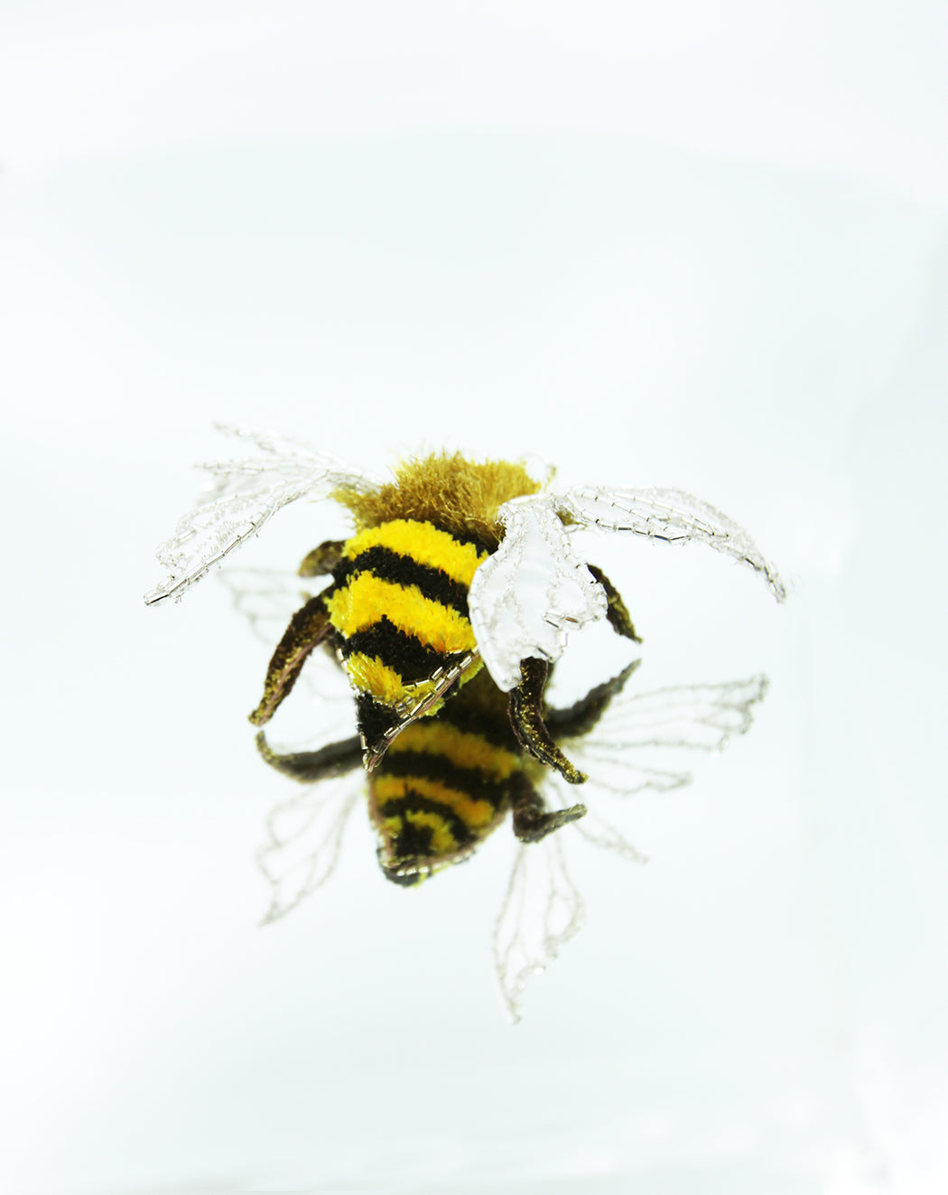 All hand embroidered bee decoration