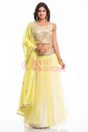 Buy Flouroscent Yellow Lehenga Choli Set at your doorstep in Delhi.