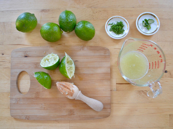 Juicing limes for key lime parfaits made with original cannoli chips