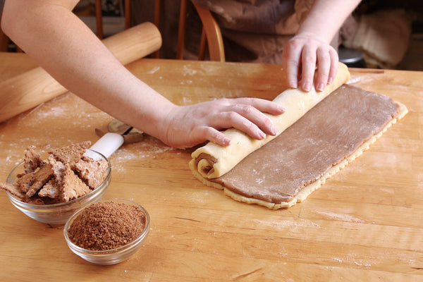 Rolling up pinwheel cookies with original cannoli chips