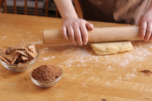 Rolling vanilla dough for cinnamon cannoli pinwheel cookies