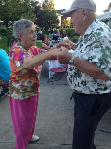 Ray and Marilyn Thompson dancing together at the long term care home.