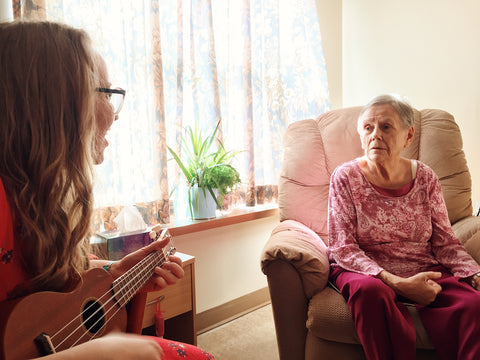 playing ukulele for grandma