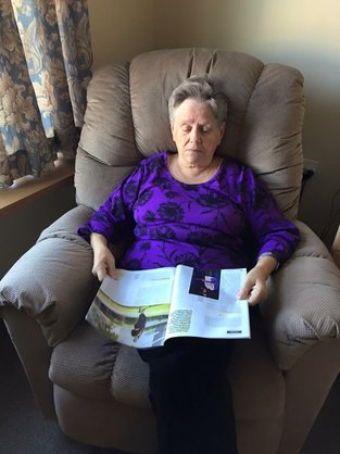 woman with dementia reading a book