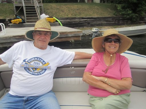 man and wife with dementia on boat smiling