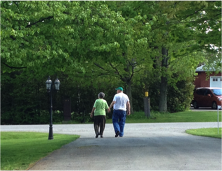 elderly couple walking in a park
