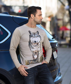 Man by a car wearing Wolf T-shirt
