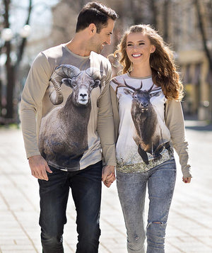 Couple wearing t-shirt with Bighorn sheep on it