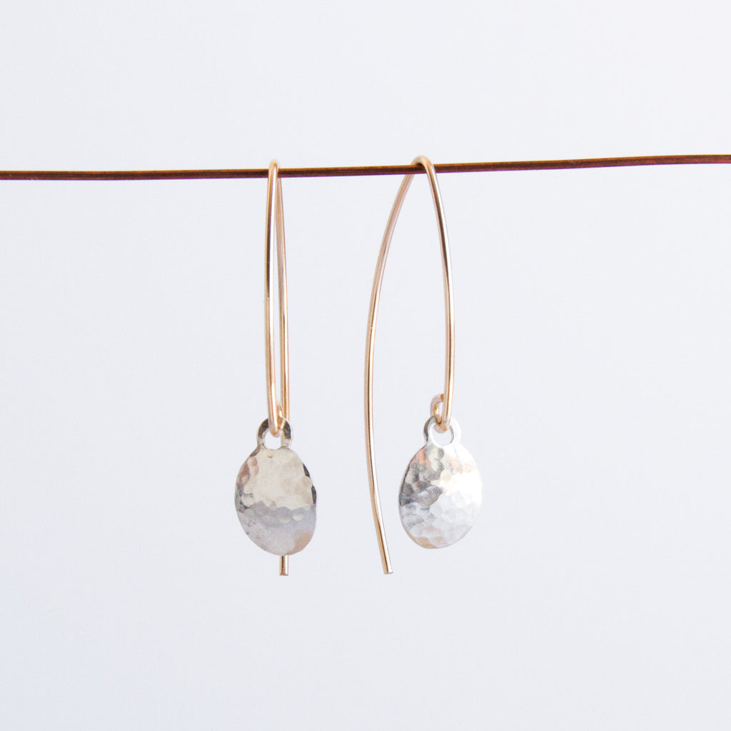 Mixed metal everyday dangle earrings by Sol Proaño