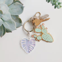 Iridescent Monstera Leaf Charm - lefty.script