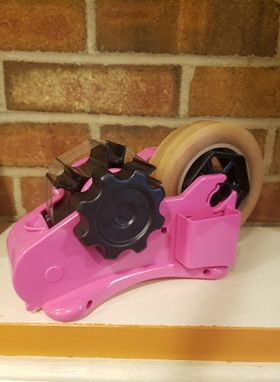 Pink Tape dispenser for our heat tape