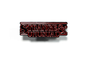 Strange & Unusual Enamel Pin