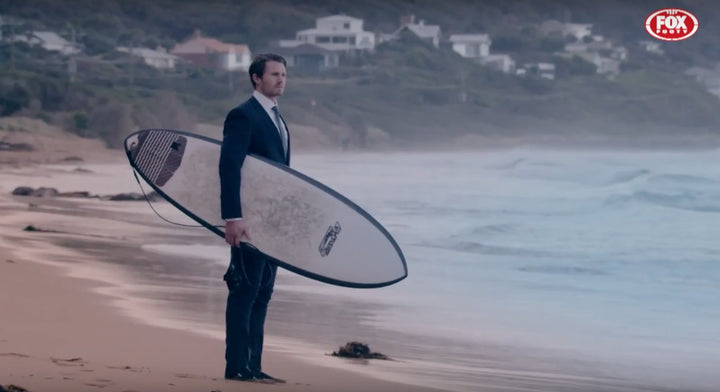 Patrick Dangerfield takes to the waves