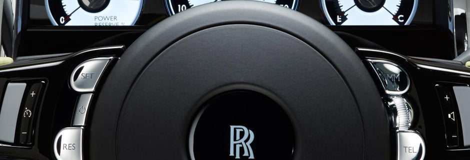 Silk lined door pockets mirror the finish of silk lined suits. - Rolls Royce Wraith