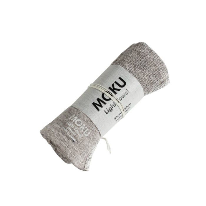 Moku Towel by Kontex is your go to towel for any active or travel situation. 100% Cotton, organic dyes and no palm oil. Highly absorbent, lightweight and quick drying, it wipes sweat away quickly and folds away small so that you can stash it in your bag. Grey, 33cm x 100cm