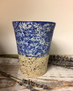 Blue cup with speckles