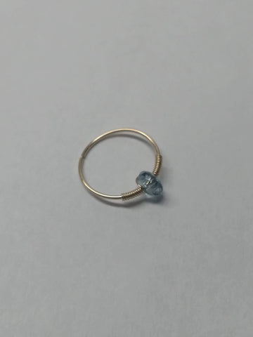 Thin yellow gold filled hoop with light blue bead