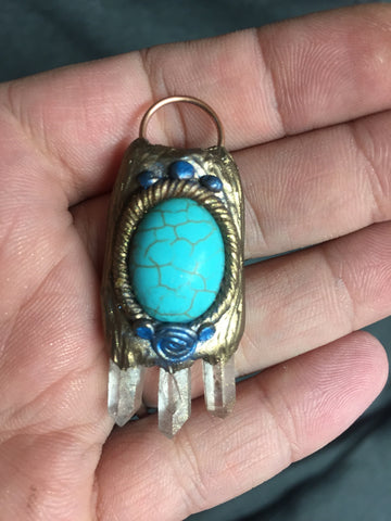 Turquoise pendant with crystals