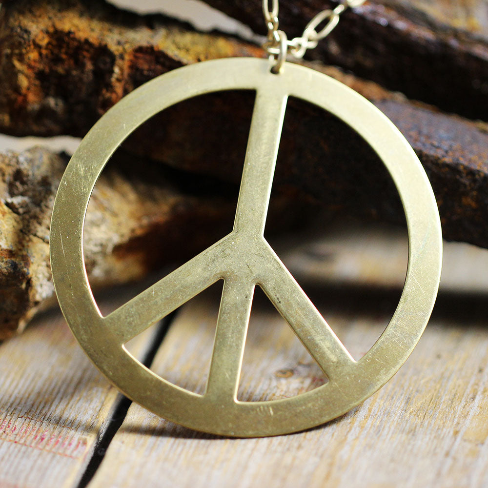 Vintage Brass Stamped Peace Sign Close